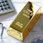 Gold bullion barr on a stocks and shares chart